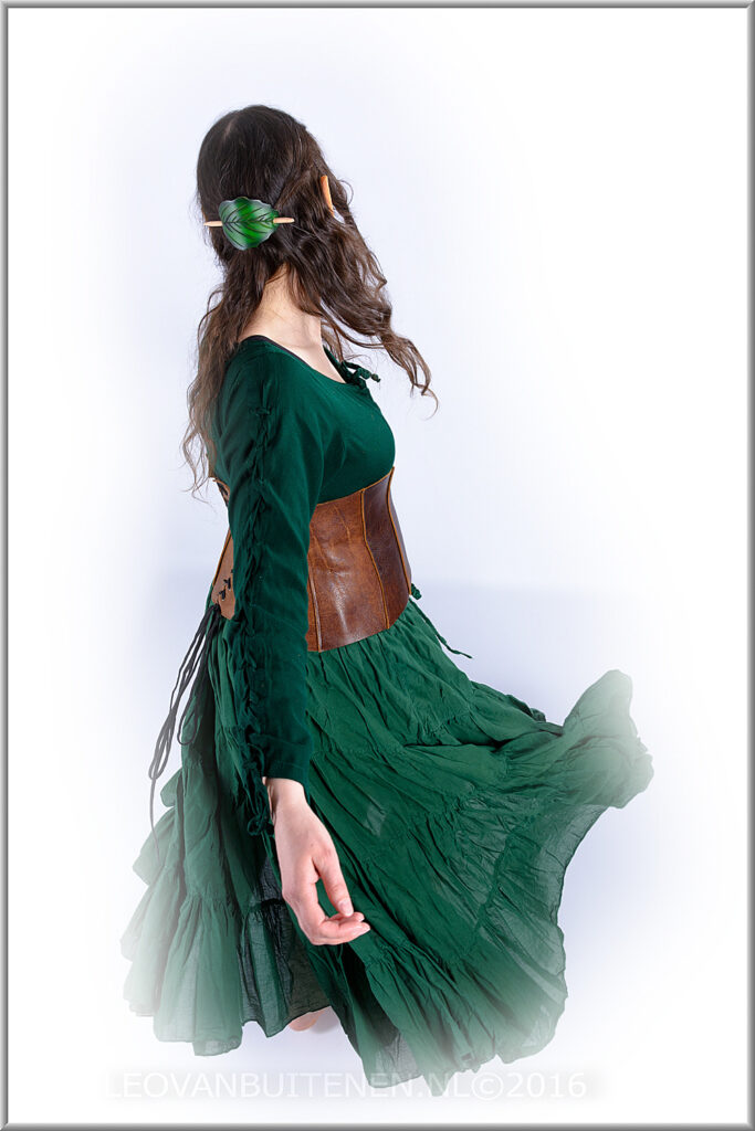 Thinkie twirling, dressed as wood elf
